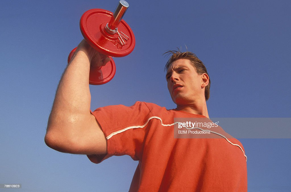 Man lifting dumbbell : Stock Photo