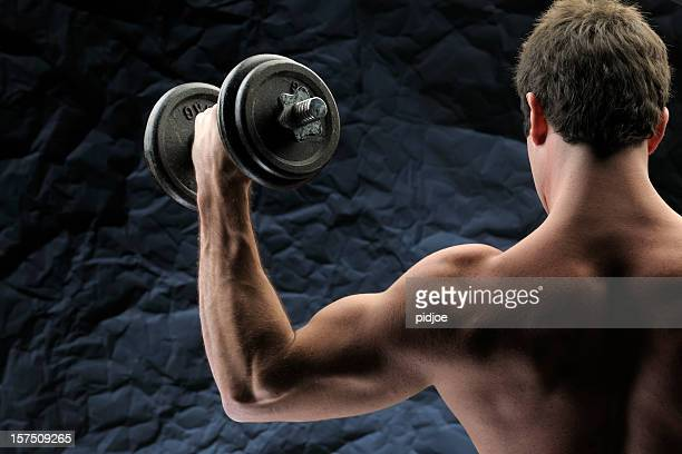 man lifting dumbbells - human muscle stock pictures, royalty-free photos & images