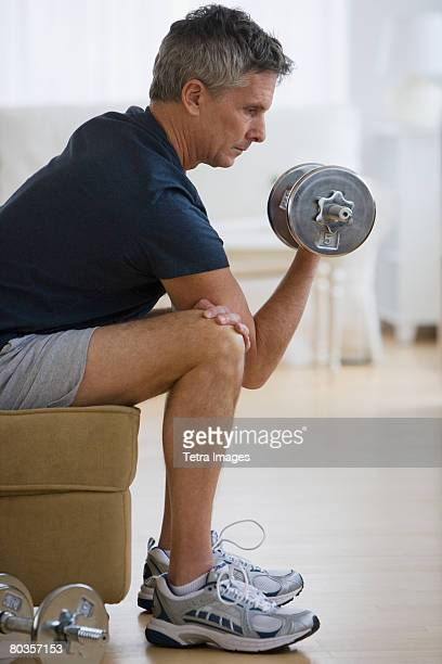 man lifting weights - hand weight stock pictures, royalty-free photos & images