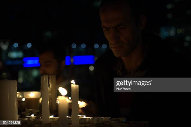 A man lighting candles in remembrance of Alan Henning at Eccles Parish Church on October 5 2014 in Salford England A video purporting to show the...