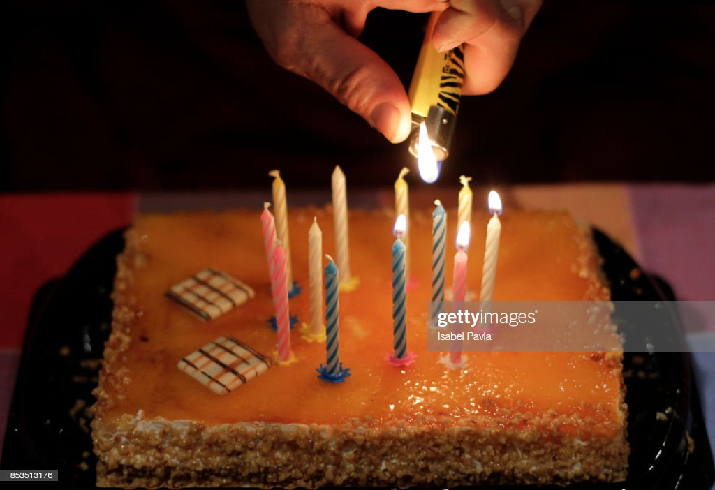 Man lighting candles on a birthday cake stock photo getty images man lighting candles on a birthday cake stock photo sciox Image collections