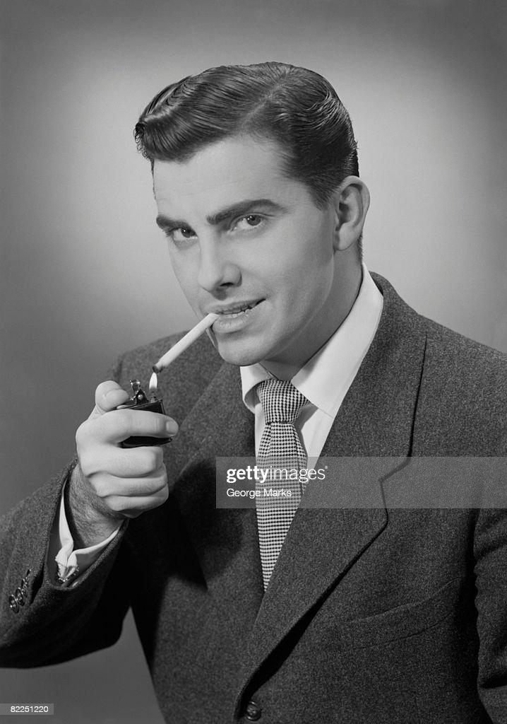 Man lighting cigarette, portrait : Stock Photo