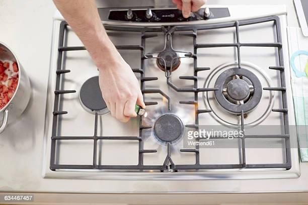 Man lighting gas stove