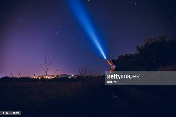 man lighting up the stars - discovery stock pictures, royalty-free photos & images