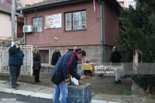 A man lights a candle where Kosovo Serb politician Oliver Ivanovic was killed in northern town of Mitrovica Kosovo on January 16 2018 Kosovo Serb...
