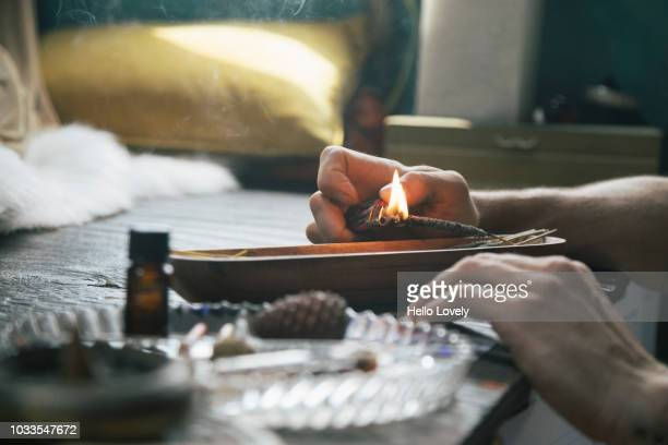 Man lights incense stick