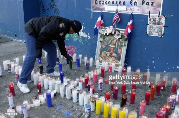 Man lights memorial candles at 163 St. And St. Nicholas Ave. In Washington Heights for those lost during the crash of American Airlines Flight 587...