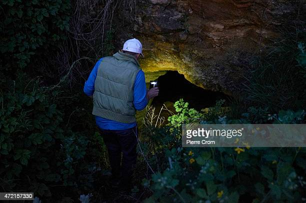 Man lights the interior of a tunnel on May 04, 2015 in Odessa, Ukraine. The tunels, called catacombes, run 100 of kilometers under Odessa ant its...