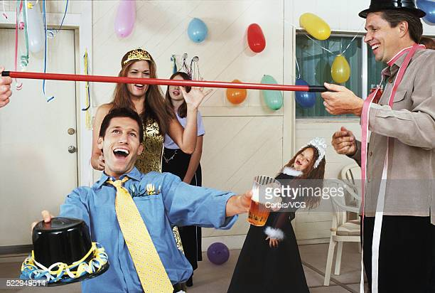Man Limbo Dancing at Party