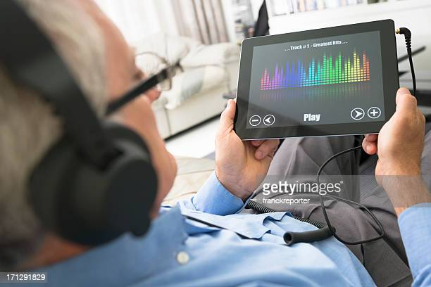 Man listening music with a digital tablet