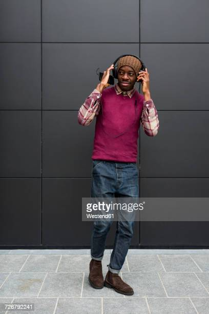 Man listening music with headphones and cell phone