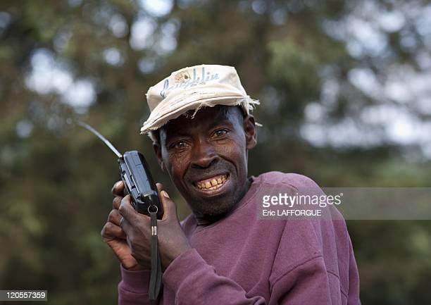 Man listening radio on road to Rehengeri in Rwanda on March 21 2010