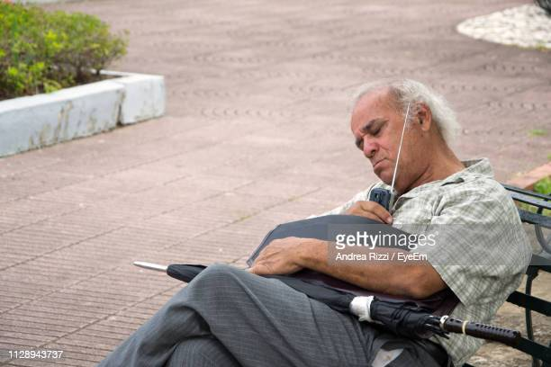 Man Listening Radio While Sleeping On Chair