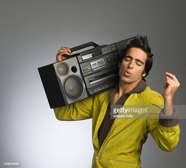 Man listening to a music system and whistling