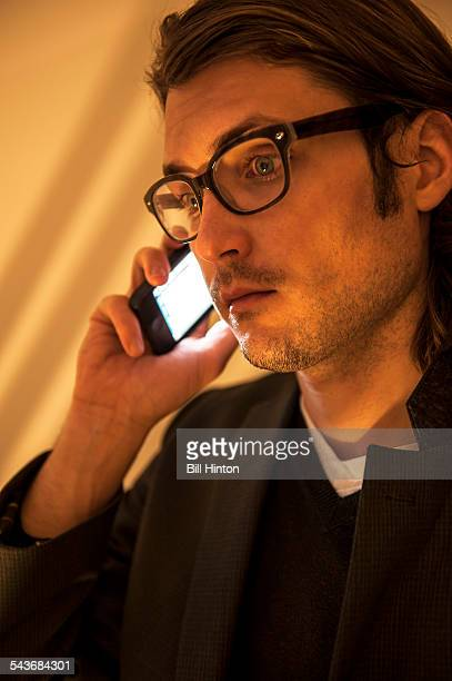 Man listening to mobile phone call at New York nightclub