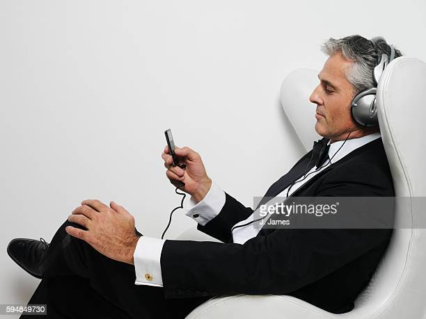 Man Listening to MP3 Player in Tuxedo