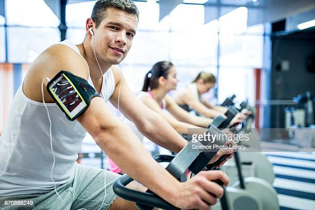 man listening to music in gym - armband stock pictures, royalty-free photos & images