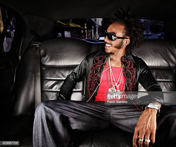 man listening to music in limousine - pimped car stock photos and pictures