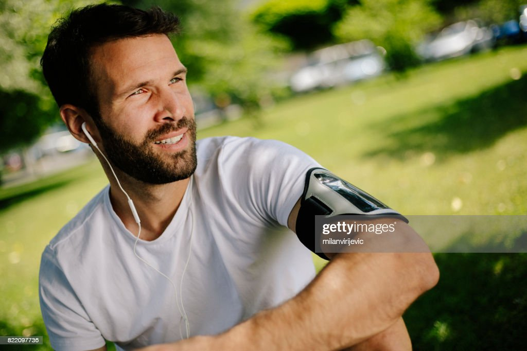 Man listening to music in nature : Stock Photo