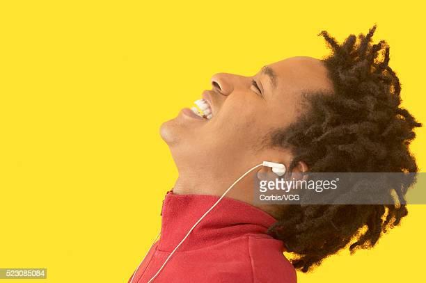Man Listening to Music on Headphones