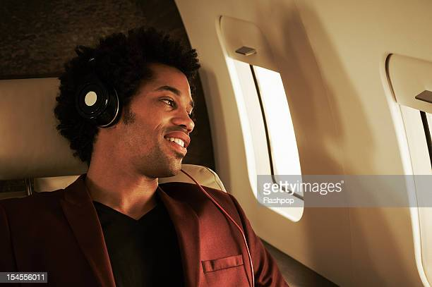 Man listening to music on private jet