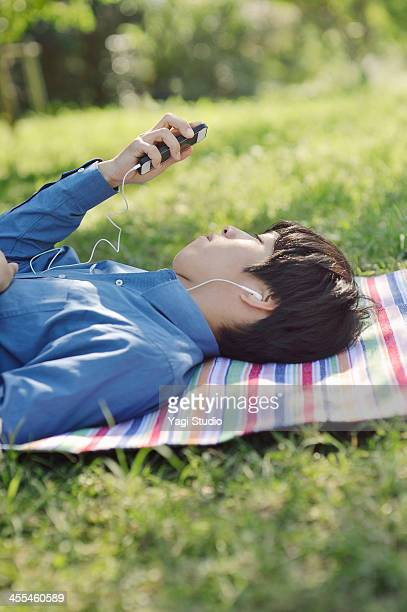 Man listening to music on smartphone in the green