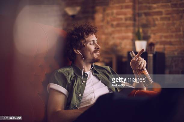 man listening to music - beer alcohol stock pictures, royalty-free photos & images