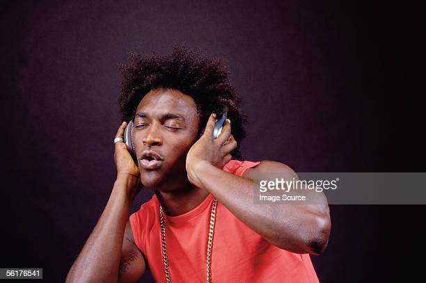 man listening to music - afro stock pictures, royalty-free photos & images