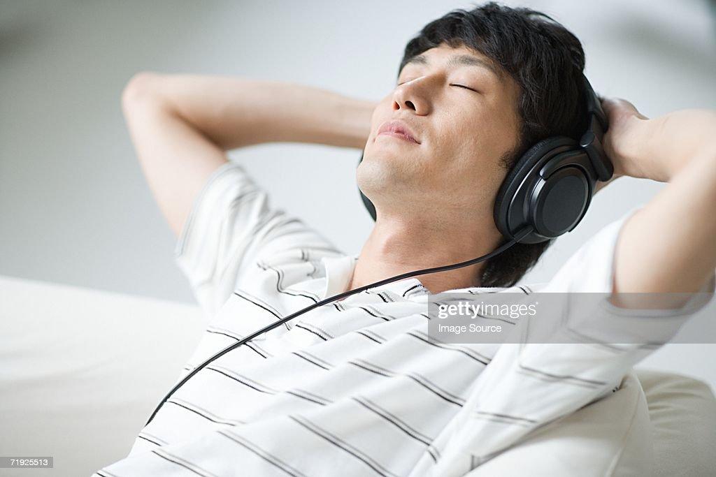 Man listening to music : Stock Photo
