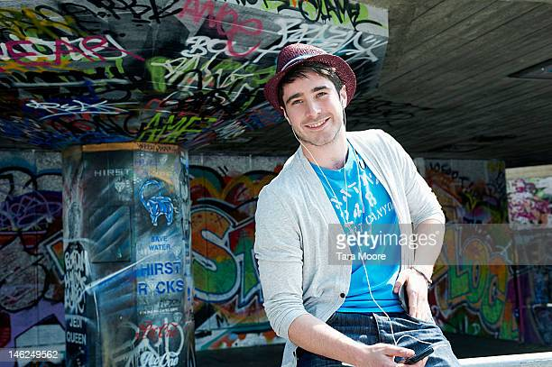 man listening to music with graffiti background