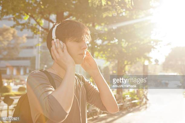 Man listening to music with headphone