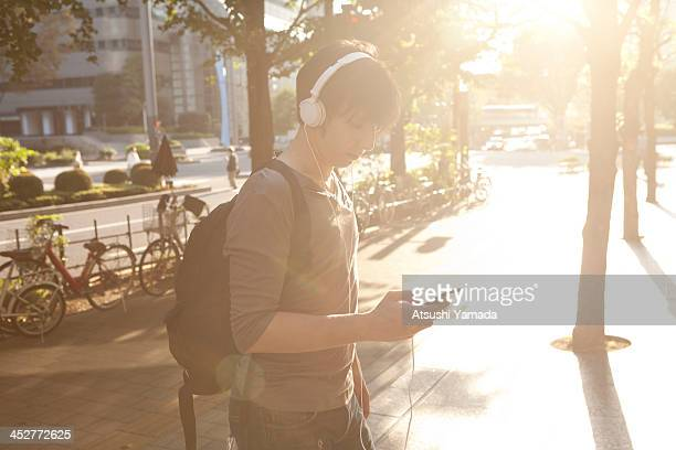 Man listening to music with smartphone