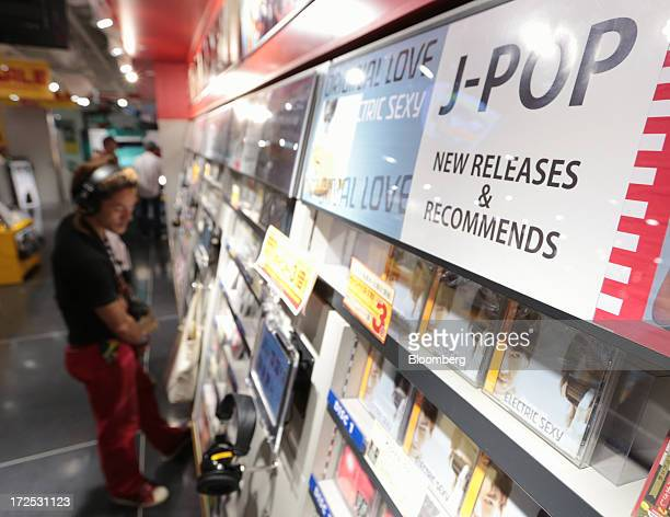 A man listens to Japanese pop music at a Tower Records Japan Inc store in Tokyo Japan on Monday July 1 2013 Music sales in the country rose for the...