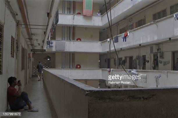 A man listens to music along the corridor of a housing complex during Movement Control Order on March 23 2020 in Kuala Lumpur Malaysia Prime Minister...