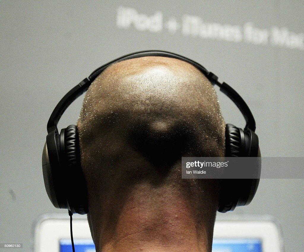 A man listens to music from an iPod at the launch of Apple's iTunes Music Store in the territories of Great Britain, Germany and France, on June 15, 2004 in London. The iTunes store allows users to buy and download albums or individual songs from a library of 700,000 songs.