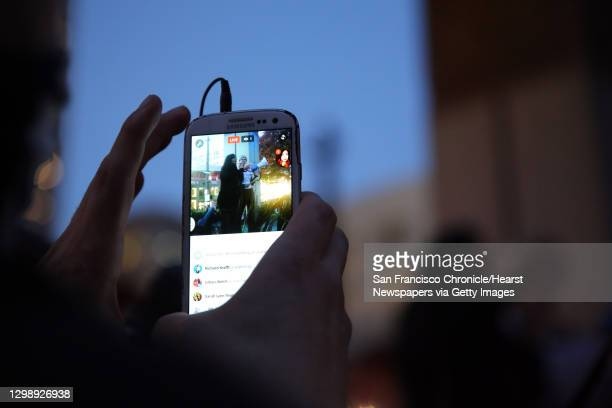 Man livestreams as Seattle city council member Kshama Sawant speaks to hundreds of anti-Donald Trump protestors at a rally in Westlake Park,...