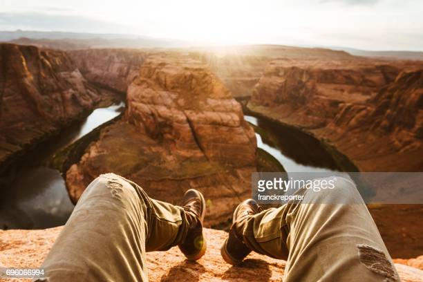 man living on the edge at the horseshoe bend