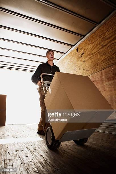 Man loading box onto truck