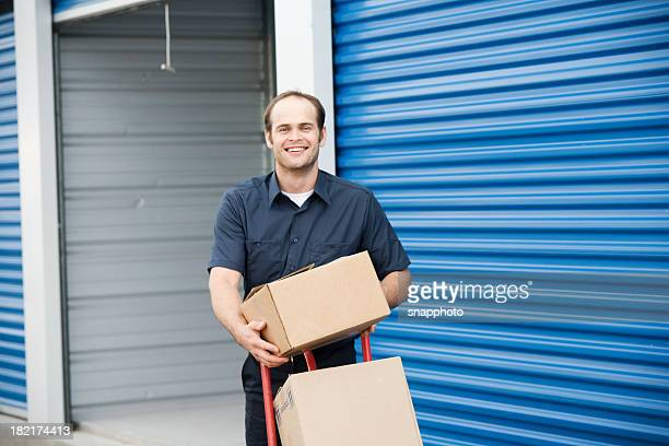 Man loading boxes for moving company at a self storage place