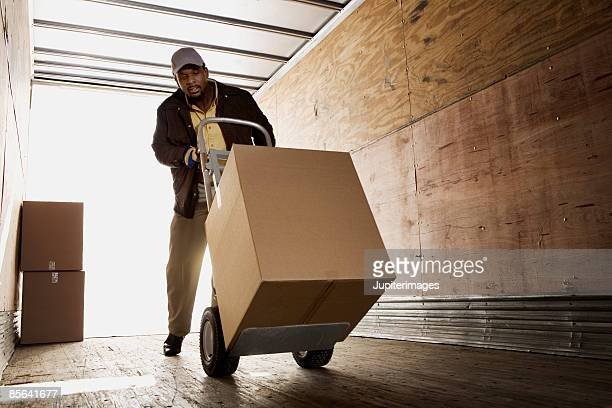 Man loading boxes onto truck