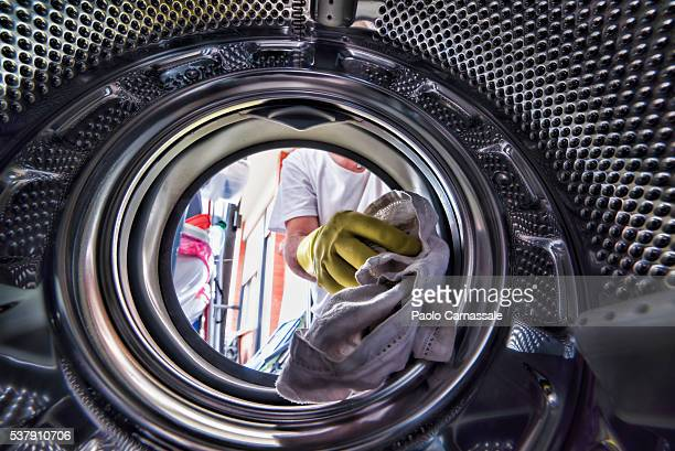 Man loading his washing machine: seens from inside