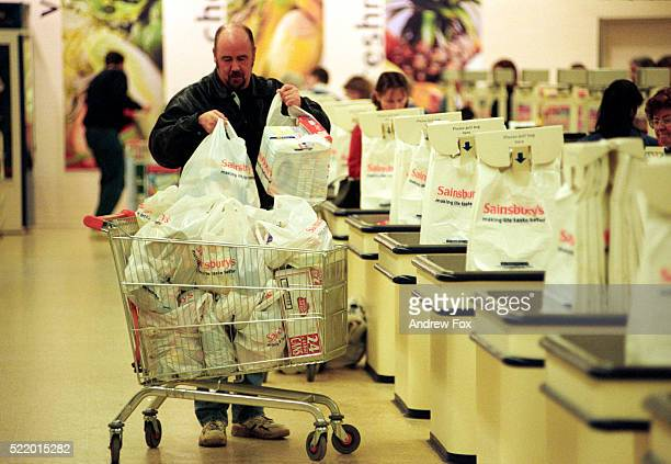 Man Loading Shopping Cart