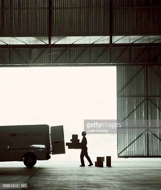 Man loading van in warehouse