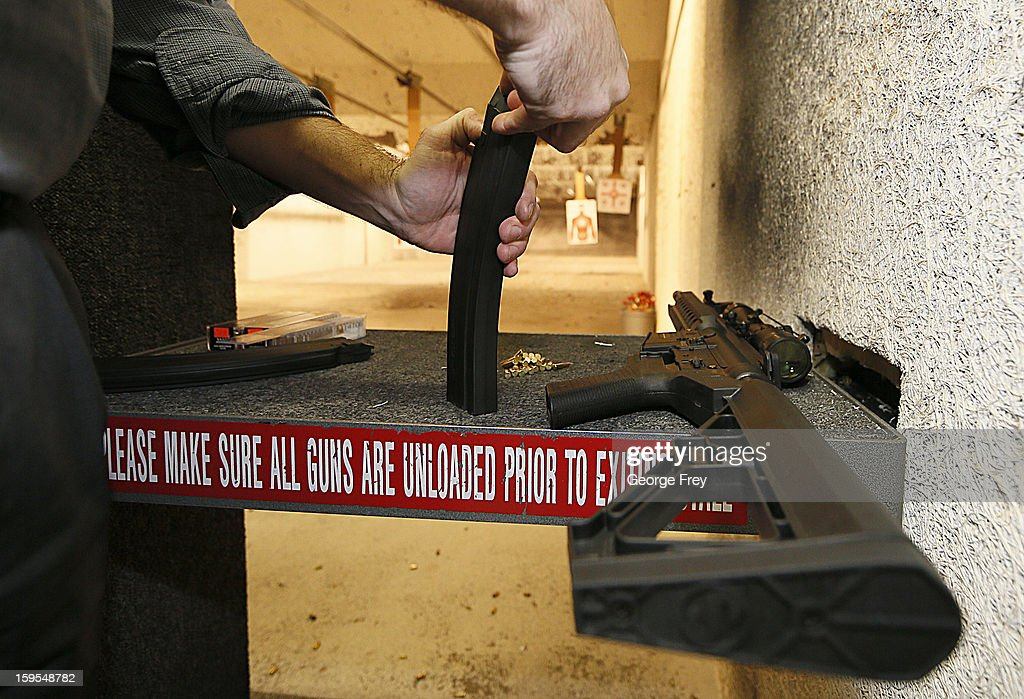A man loads a high capacity ammo clip for an 22 Cal. look-alike AR-15 rifle at the 'Get Some Guns & Ammo' shooting range on January 15, 2013 in Salt Lake City, Utah. Lawmakers are calling for tougher gun legislation after recent mass shootings at an Aurora, Colorado movie theater and at Sandy Hook Elementary School in Newtown, Connecticut.