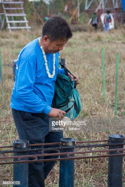 A man loads fireworks for launch as a gesture to god for the sake of the rainy season during the Ban Bung Fai Rocket Festival in Yasothon Thailand