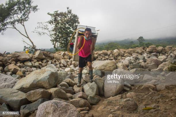 A man loads objects from his house after the avalanche of last 01 April which affected to 17 neighbourhoods in Mocoa Colombia 04 April 2017