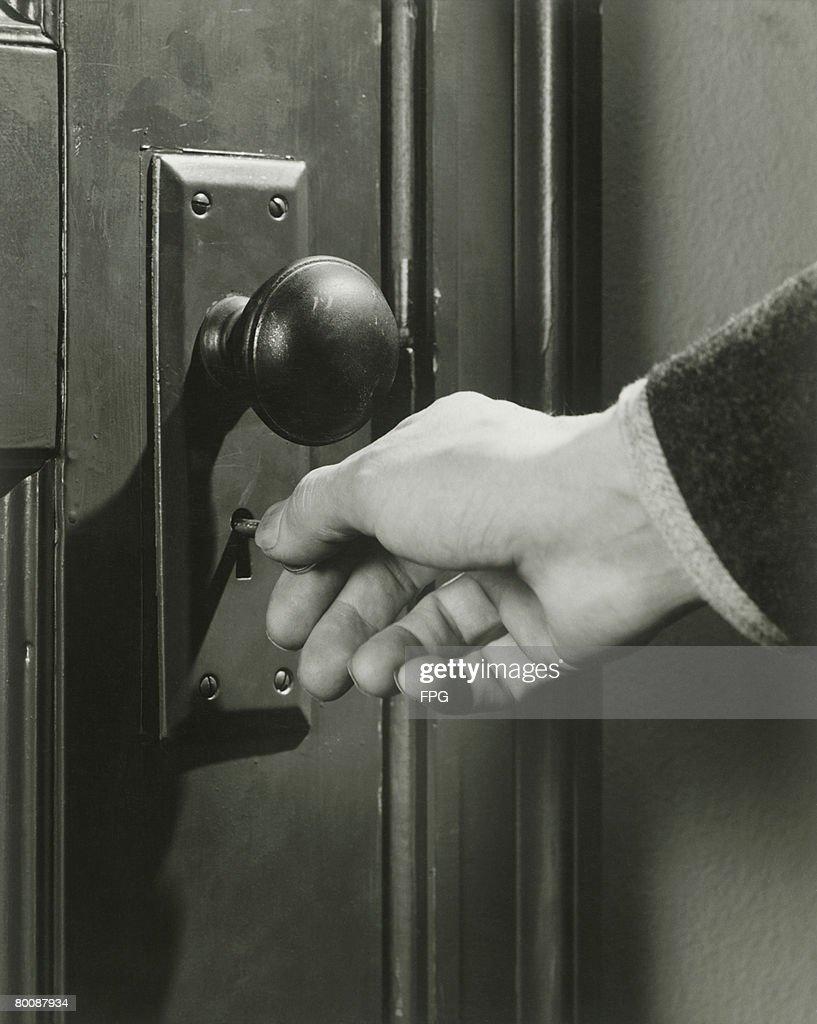 Man locking door, close-up : Stock Photo