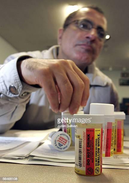 A man logs perscription drug information as he registers his parents for the new Medicare drug prescription program during a Medicare enrollment...