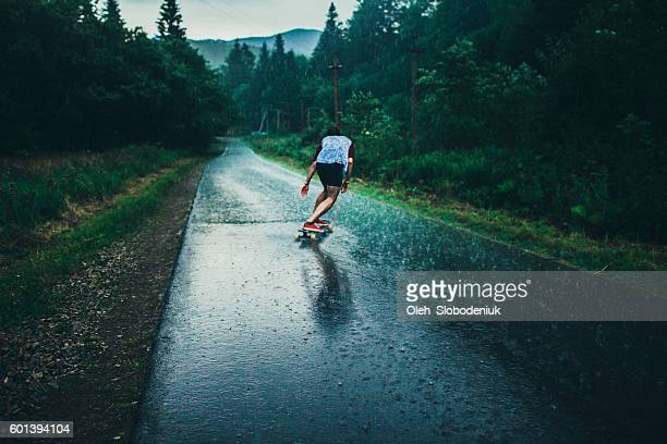 man longboarding - skating stock photos and pictures