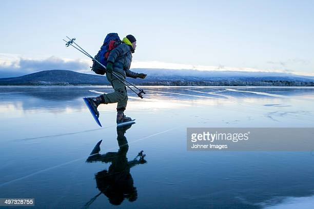 man long-distance skating, kiruna, lapland, sweden - swedish lapland stock photos and pictures